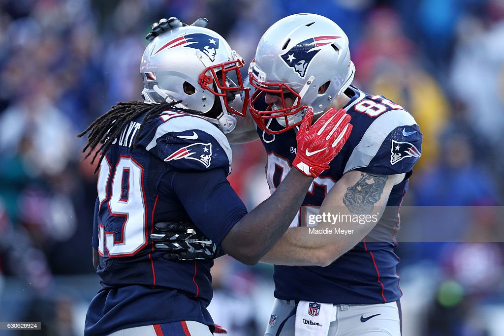 LeGarrette Blount #29 of the New England Patriots celebrates with Matt Lengel #82 after scoring against the New York Jets during the second half at Gillette Stadium on December 24, 2016 in Foxboro, Massachusetts.
