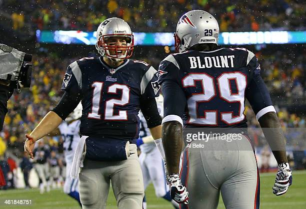 LeGarrette Blount of the New England Patriots celebrates with teammate Tom Brady in the end zone after scoring a 2 yard touchdown in the first...