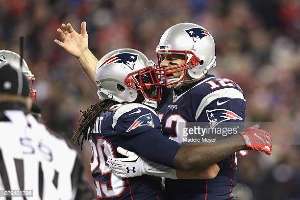 LeGarrette Blount of the New England Patriots celebrates with Tom Brady after rushing for a touchdown during the first quarter against the Baltimore...