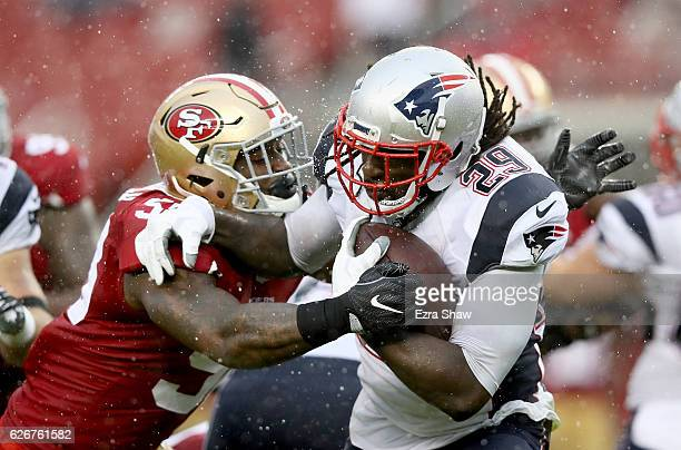LeGarrette Blount of the New England Patriots is tackled by Eli Harold of the San Francisco 49ers at Levi's Stadium on November 20 2016 in Santa...
