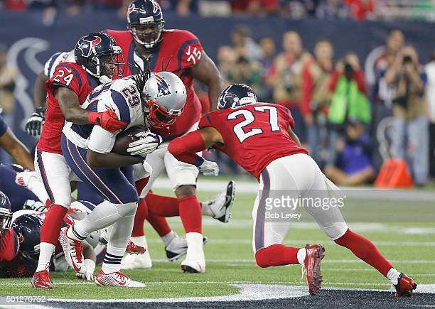 LeGarrette Blount of the New England Patriots is tackled by Johnathan Joseph and Quintin Demps of the Houston Texans in the second quarter on...