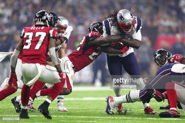 LeGarrette Blount of the New England Patriots is tackled by Keanu Neal of the Atlanta Falcons during Super Bowl 51 at NRG Stadium on February 5 2017...
