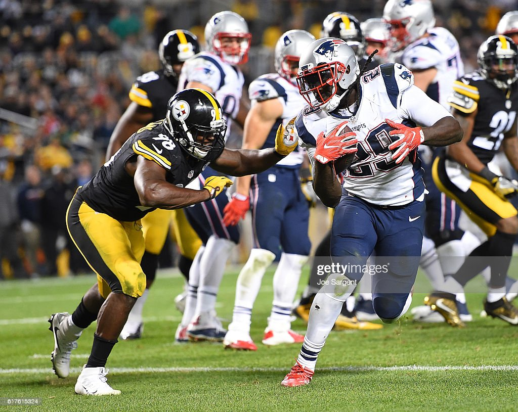 LeGarrette Blount #29 of the New England Patriots rushes against Vince Williams #98 of the Pittsburgh Steelers in the second half during the game at Heinz Field on October 23, 2016 in Pittsburgh, Pennsylvania.