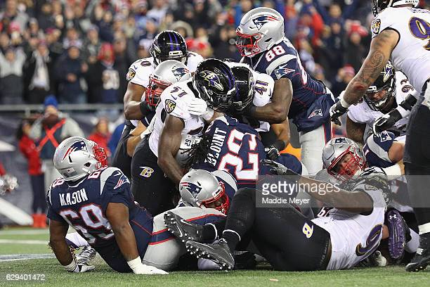 LeGarrette Blount of the New England Patriots rushes for a 1-yard touchdown during the first quarter against the Baltimore Ravens at Gillette Stadium...
