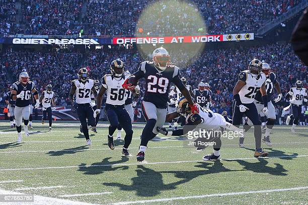 LeGarrette Blount of the New England Patriots rushes for a 43yard touchdown during the first quarter against the Los Angeles Rams at Gillette Stadium...