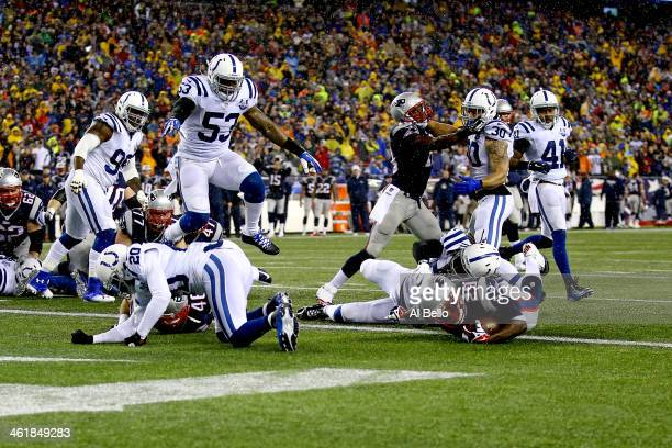 LeGarrette Blount of the New England Patriots scores a 2 yard touchdown in the first quarter against the Indianapolis Colts during the AFC Divisional...