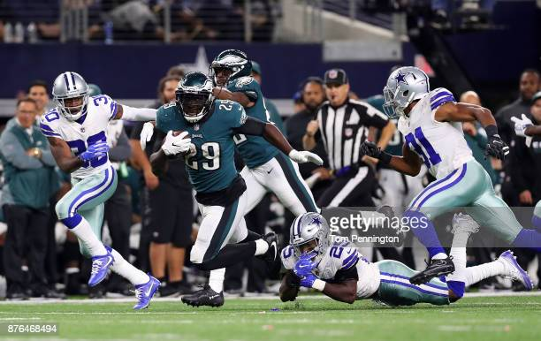 LeGarrette Blount of the Philadelphia Eagles carries the ball against Byron Jones of the Dallas Cowboys Xavier Woods of the Dallas Cowboys and Byron...