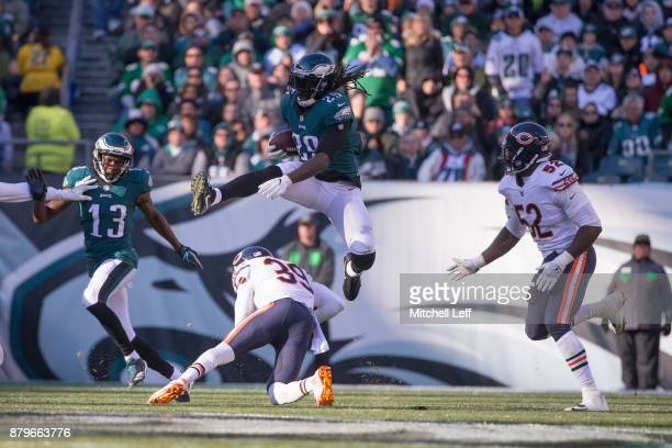LeGarrette Blount of the Philadelphia Eagles hurdles over Eddie Jackson of the Chicago Bears to run for a first down in the second quarter at Lincoln...