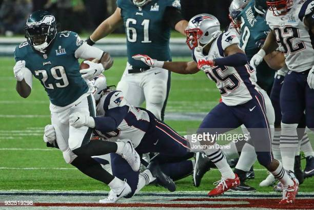 LeGarrette Blount of the Philadelphia Eagles is grabbed by Malcom Brown of the New England Patriots during Super Bowl Lll at US Bank Stadium on...