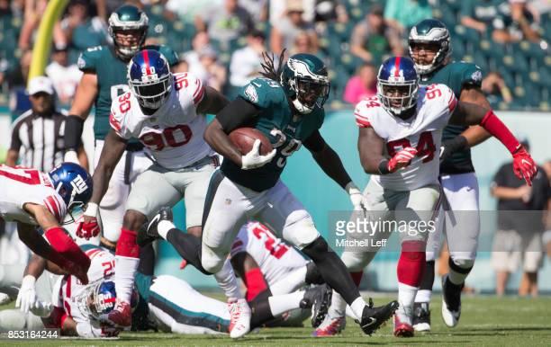 LeGarrette Blount of the Philadelphia Eagles runs the ball against Jason PierrePaul and Dalvin Tomlinson of the New York Giants in the third quarter...