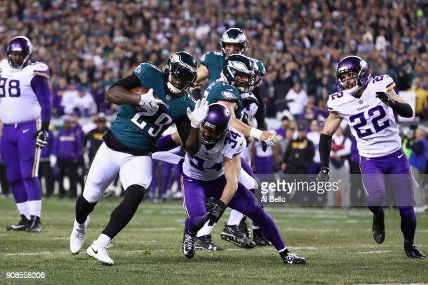 LeGarrette Blount of the Philadelphia Eagles scores a second quarter rushing touchdown past Andrew Sendejo of the Minnesota Vikings in the NFC...