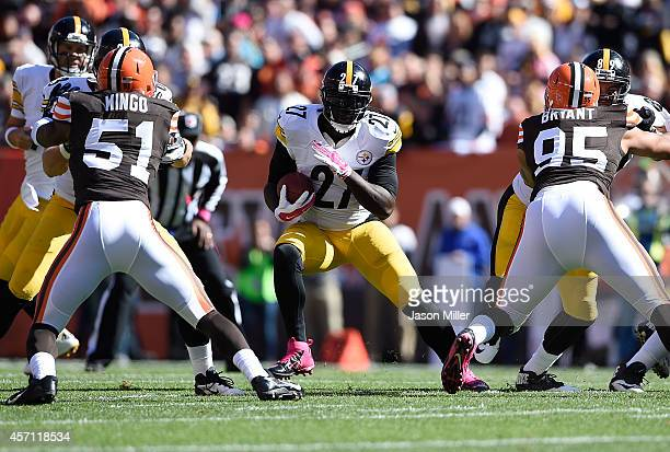LeGarrette Blount of the Pittsburgh Steelers carries the ball between the defense of Barkevious Mingo and Armonty Bryant of the Cleveland Browns at...