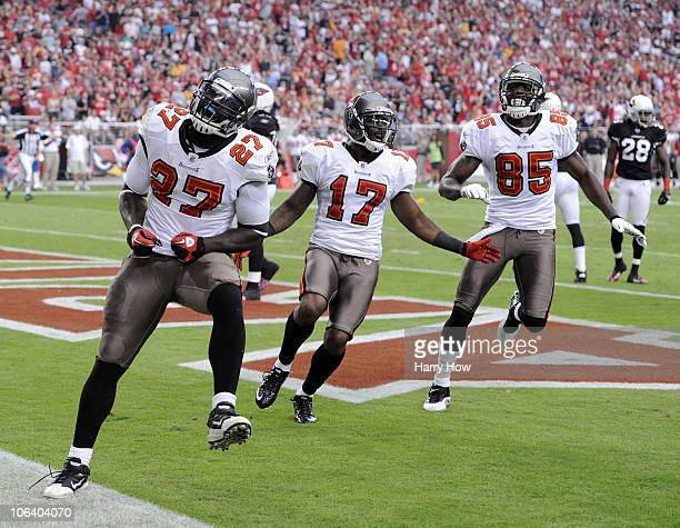 LeGarrette Blount of the Tampa Bay Buccaneers celebrates his touchdown with Arrelious Benn and Maurice Stovall for a 31-14 lead over the Arizona...