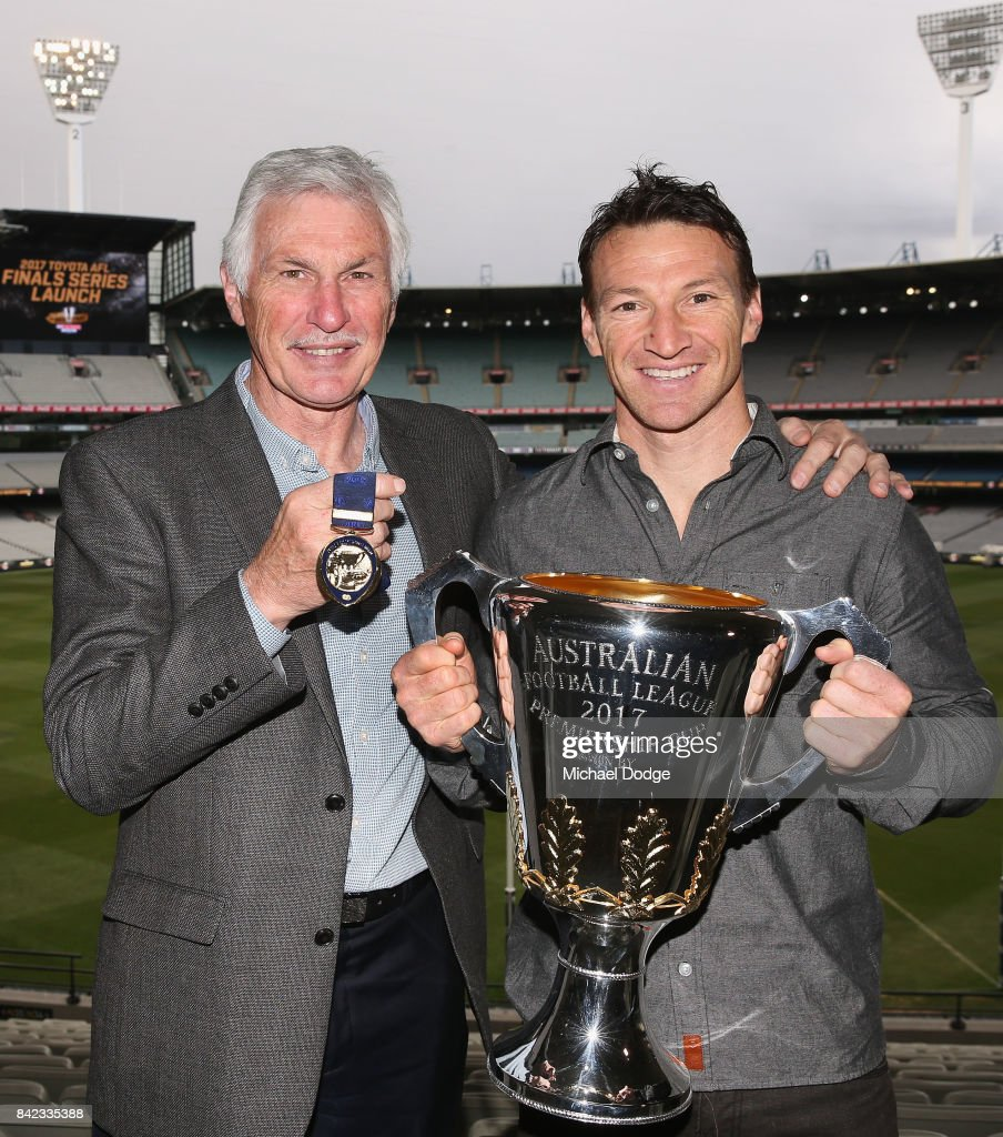 Legend AFL coach Michael Malthouse (L) poses with the Jock McHale medal and AFL games record holder Brent Harvey poses with the AFL Premiership Cup during the 2017 AFL Finals Launch at Melbourne Cricket Ground on September 4, 2017 in Melbourne, Australia. Malthouse will present the medal on Grandfinal day and Harvey is the AFL Premiership Cup Ambassador.
