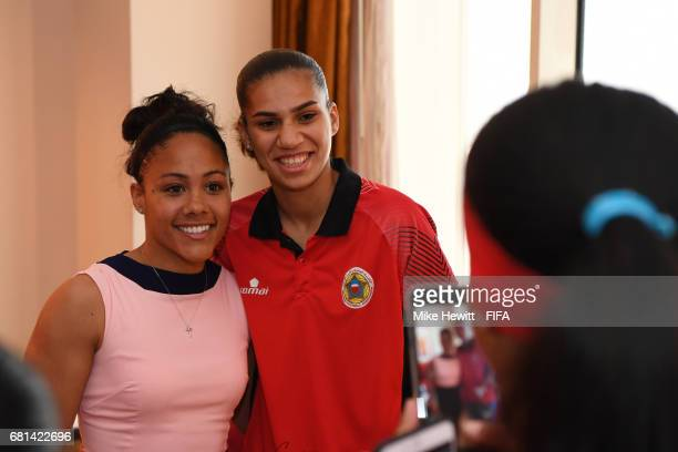 Legend Alex Scott poses for a photo with a member of the Bahrain Women's National team at the Diplomat Radisson BLU hotel ahead of the 67th FIFA...
