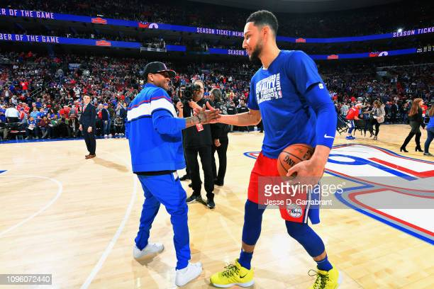 NBA legend Allen Iverson and Ben Simmons of the Philadelphia 76ers high five during the game against the Denver Nuggets on February 8 2019 at the...