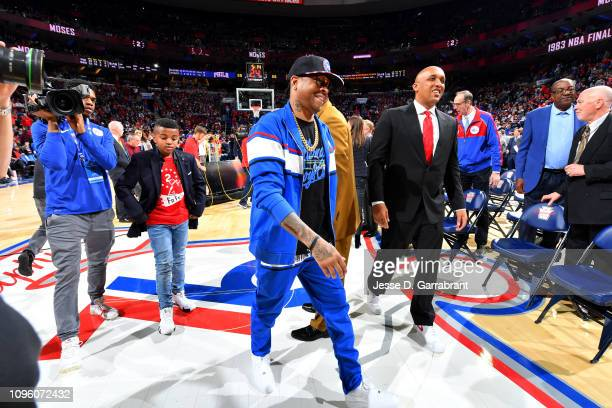 NBA legend Allen Iverson attends Moses Malone's jersey retirement ceremony during the game between the Denver Nuggets and the Philadelphia 76ers on...