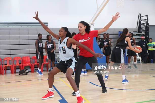Legend Allison Feaster goes over drills with the campers at the Basketball Without Boarders Africa program at the American International School of...