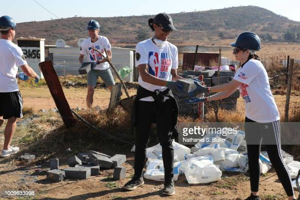 Legend Allison Feaster helps to build during the Habitat for Humanity event as part of the Basketball Without Boarders Africa program at Lawly...