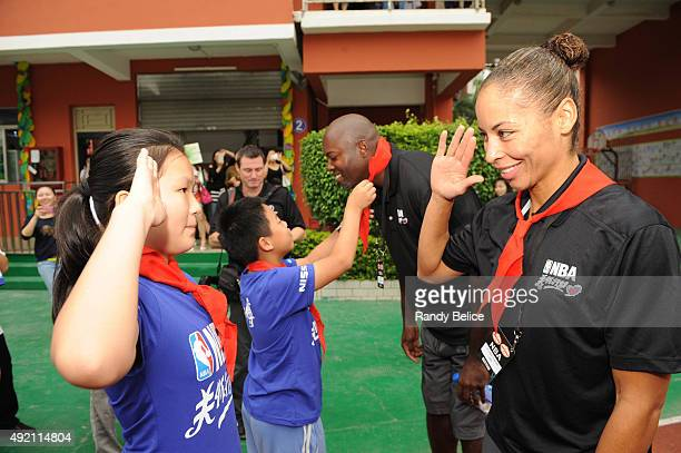 Legend Allison Feaster interacts with the kids during the Shenzhen Learn and Cares dedication as part of the 2015 Global Games China at the Jianlian...