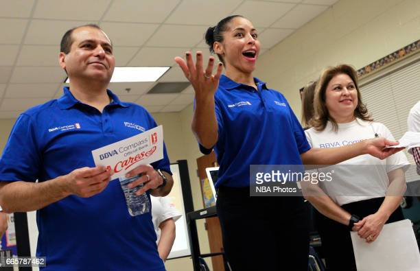 WNBA Legend Allison Feaster right and BBVA Compass' Rey Ocanas talks to students about being responsible with money at Victor Fields Elementary...
