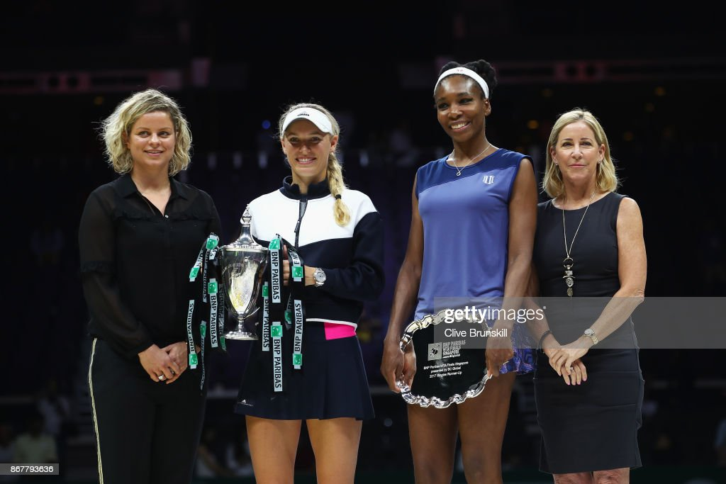 WTA Legend Ambassador Kim Clijsters, winner Caroline Wozniacki of Denmark, Venus Williams of the United States and WTA Legend Ambassador Chris Evert pose after the Singles Final during day 8 of the BNP Paribas WTA Finals Singapore presented by SC Global at Singapore Sports Hub on October 29, 2017 in Singapore.