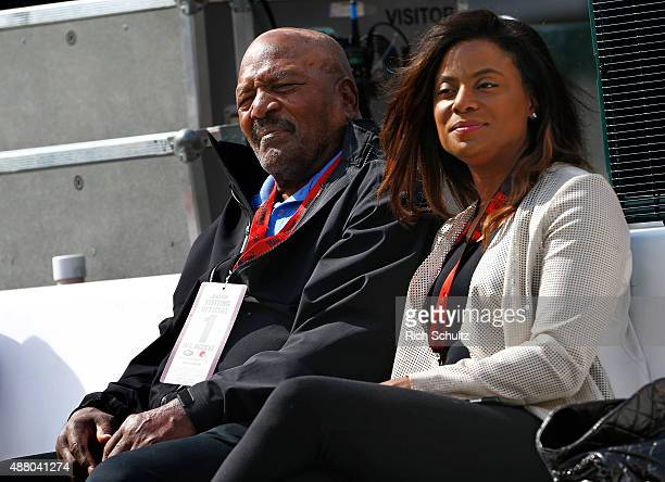 Legend and former Cleveland Browns running back, Jim Brown and his wife Monique watch the pre game workouts before a game against the New York Jets...