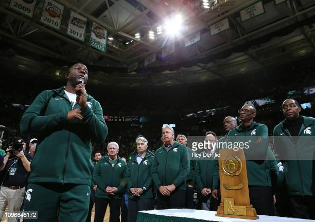 NBA legend and former Michigan State star Earvin Magic Johnson speaks to the crowd during halftime of the game between the Michigan State Spartans...