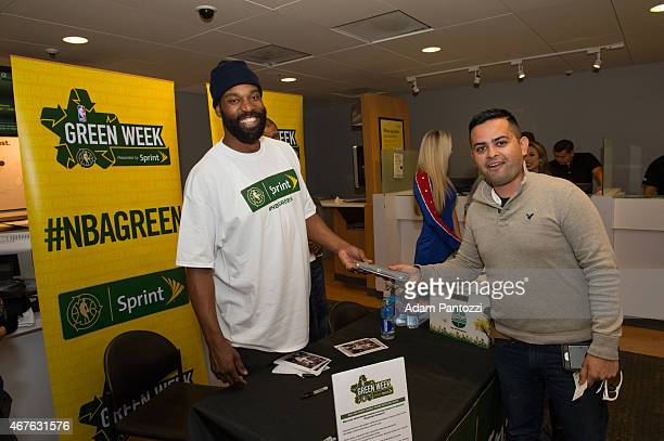 Legend Baron Davis and members of the Clippers Spirit dance team participate in an NBA Green week e-recycling event at a Sprint Retail Store on March...