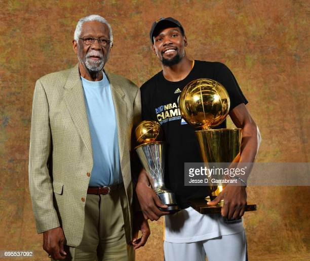 Legend Bill Russell and Kevin Durant of the Golden State Warriors poses for a portrait with the Larry O'Brien Trophy after defeating the Cleveland...