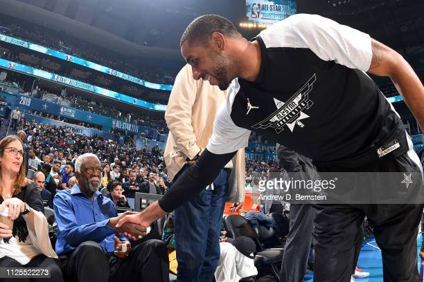 NBA legend Bill Russell and LaMarcus Aldridge of Team LeBron shake hands before the 2019 NBA AllStar Game on February 17 2019 at the Spectrum Center...