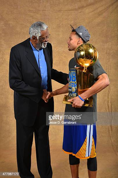 Legend Bill Russell and Stephen Curry of the Golden State Warriors poses for a portrait with the Larry O'Brien trophy after defeating the Cleveland...