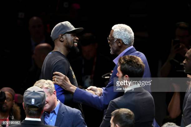 OH NBA legend Bill Russell high fives Kevin Durant of the Golden State Warriors celebrates during the Larry O'Brien Trophy ceremony after winning the...