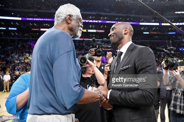 NBA legend Bill Russell shakes hands with Kobe Bryant at halftime after both of Bryant's and Los Angeles Lakers jerseys are retired at Staples Center...