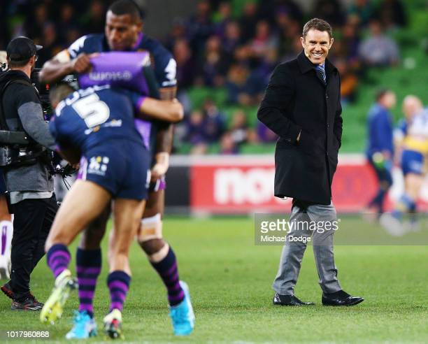 NRL legend Brad Fittler reacts as he watches Storm players warm up during the round 23 NRL match between the Melbourne Storm and the Parramatta Eels...