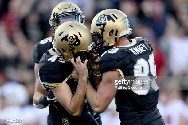 Legend Brumbaugh Alex Kinney and Evan Price of the Colorado Buffaloes celebrate a game winning field goal by Price against Stanford Cardinal in the...