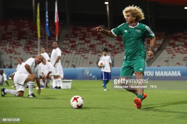 Legend Carlos Valderrama of Columbia controlls the ball during a FIFA Football Tournament ahead of the 67th FIFA Congress at Bahrain National Stadium...