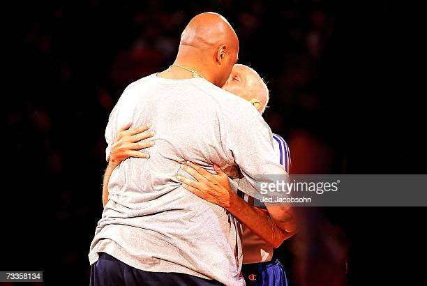 NBA legend Charles Barkley kisses referee Dick Bavetta after they competed in a fullcourt race in the Bavetta/Barkley Challenge during NBA AllStar...