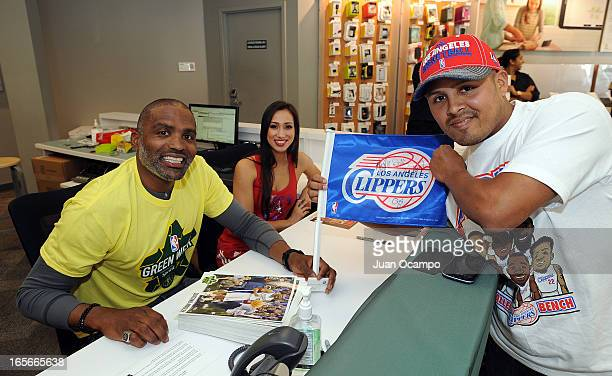Legend Cuttino Mobley poses for a photo with a fan during NBA Green Week presented by Sprint E Recycling on April 4 2013 at the Sprint store in...