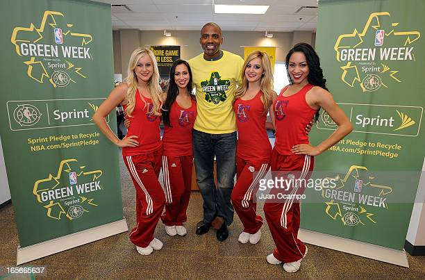 Legend Cuttino Mobley poses with members of the Clippers Sprit dance team during NBA Green Week presented by Sprint E Recycling on April 4 2013 at...
