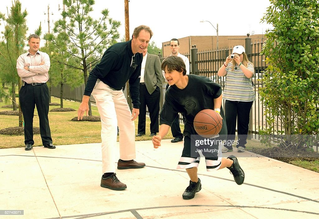 legend dave cowens plays basketball with a boy during an nba legends