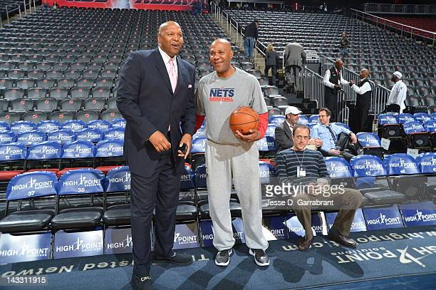 Legend Derrick Coleman left speaks to Mario Elie assistant coach of the New Jersey Nets before the Nets hosted the Philadelphia 76ers on April 23...