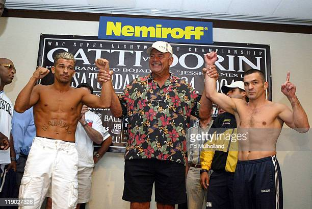 NFL Legend Dick Butkus raises the arms of Arturo Gatti and Leonard Dorin at the weighin for their WBC Junior Welterweight Championship fight Saturday...
