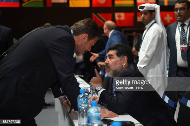 Legend Diego Maradona talks to FIFA Deputy Secretary General Zvonimir Boban during the 67th FIFA Congress at the Bahrain International Exhibition &...