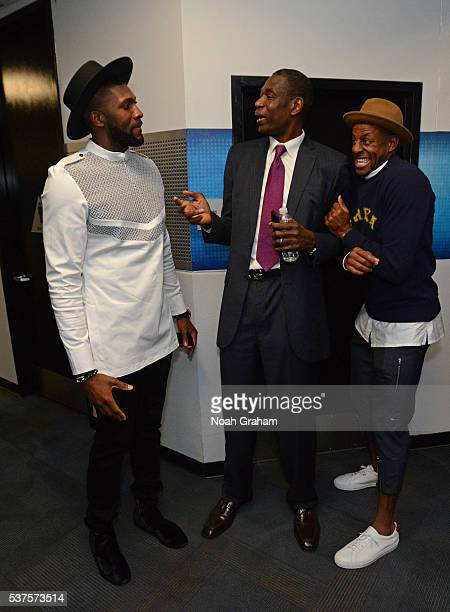 Legend Dikembe Mutombo talks to Andre Iguodala and Festus Ezeli of the Golden State Warriors after Game Five of the Western Conference Finals against...