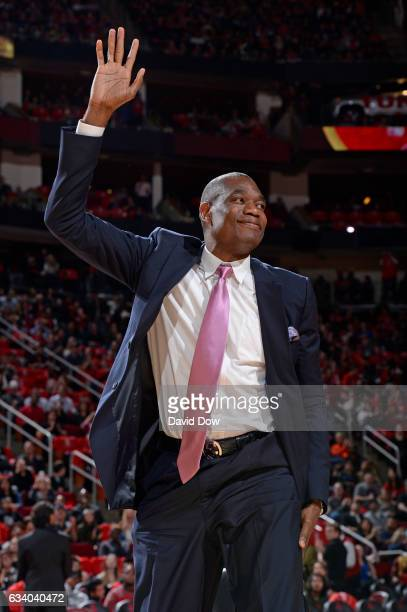Legend Dikembe Mutumbo waves to the crowd during the Yao Ming jersey retirement ceremony during the Chicago Bulls game against the Houston Rockets on...