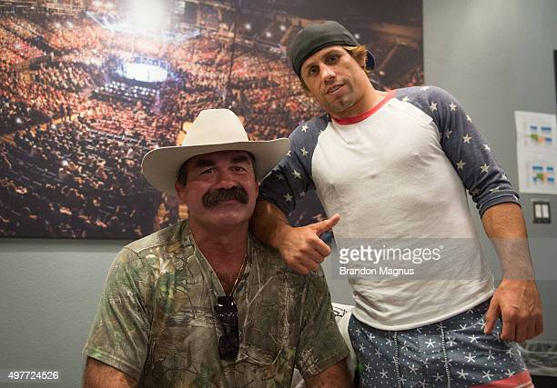 Legend Don Frye and Urijah Faber pose for a photo during the filming of The Ultimate Fighter Team McGregor vs Team Faber at the UFC TUF Gym on August...