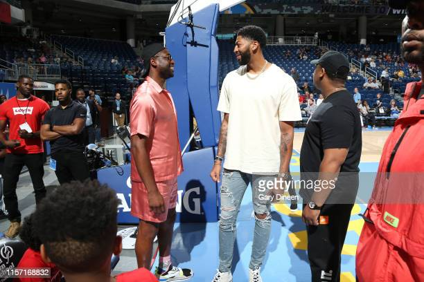 NBA legend Dwyane Wade talks with Anthony Davis of the Los Angeles Lakers before the game on July 21 2019 at the Wintrust Arena in Chicago Illinois...