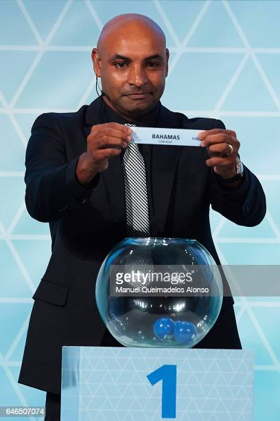 Legend Emerson Ferreira holds up the name of Bahamas during the Official Draw FIFA Beach Soccer World Cup Bahamas 2017 at Atlantis Hotel Theatre on...