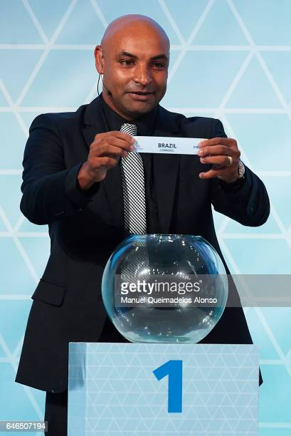 Legend Emerson Ferreira holds up the name of Brazil during the Official Draw FIFA Beach Soccer World Cup Bahamas 2017 at Atlantis Hotel Theatre on...